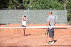 Тренер по большому теннису